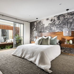 This is an example of a contemporary bedroom in Perth with white walls, medium hardwood floors and brown floor.
