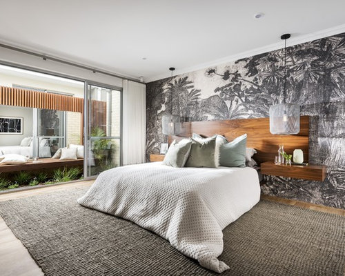 This Is An Example Of A Contemporary Bedroom In Perth With White Walls,  Medium Hardwood