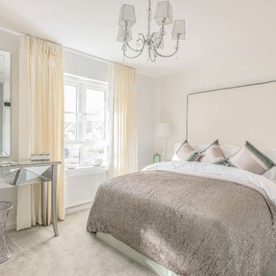 This is an example of a medium sized classic guest bedroom in Edinburgh with white walls, carpet and grey floors.