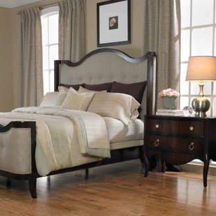 Large elegant master medium tone wood floor bedroom photo in Atlanta with beige walls and no fireplace