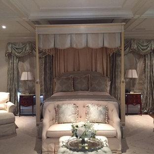 Mid-sized victorian master bedroom in San Diego with beige walls, dark hardwood floors and brown floor.