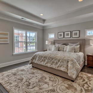 Inspiration for a mid-sized timeless master dark wood floor bedroom remodel in San Diego with beige walls