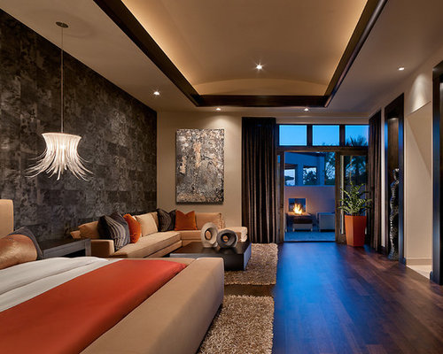 Example Of An Island Style Bedroom Design In Phoenix With Multicolored  Walls And Dark Wood Floors