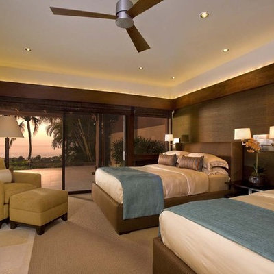 Example of an island style guest bedroom design in Hawaii with brown walls