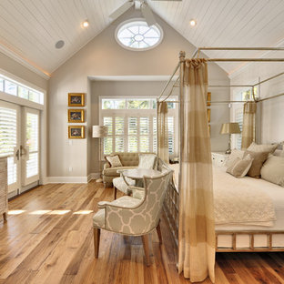 Bedroom - beach style medium tone wood floor bedroom idea in Philadelphia with beige walls
