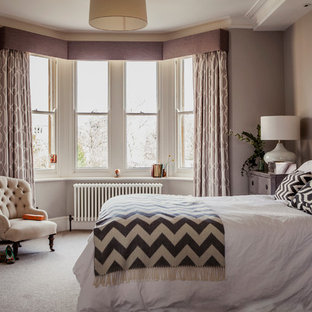 Inspiration for a mid-sized transitional master carpeted bedroom remodel in Hampshire with gray walls