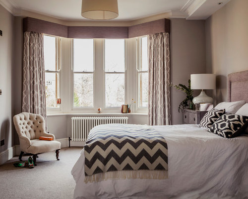 Inspiration for a medium sized traditional master bedroom in hampshire with grey walls and carpet