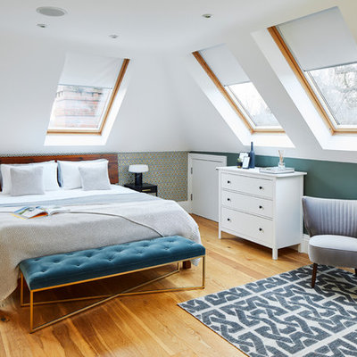 Example of a large trendy bedroom design in Surrey