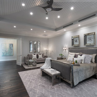 Example of a coastal master dark wood floor bedroom design in Tampa with gray walls and no fireplace