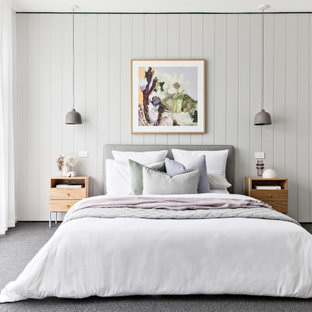Photo of a scandinavian bedroom in Melbourne with grey walls, carpet and grey floor.
