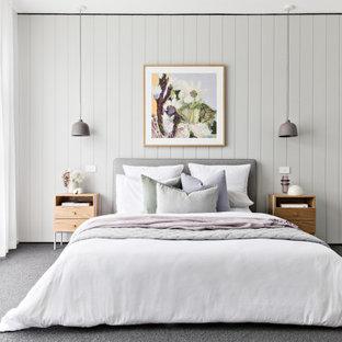 Photo of a scandinavian bedroom in Melbourne with grey walls, carpet and grey floor.