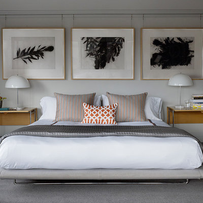 Example of a large transitional master carpeted bedroom design in San Francisco with white walls