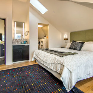 Example of a trendy medium tone wood floor bedroom design in San Francisco with white walls