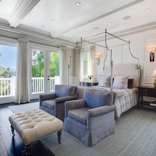 Design ideas for a beach style bedroom in Los Angeles with beige walls, dark hardwood floors, black floor, exposed beam and timber.