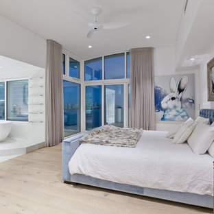 Photo of a large contemporary master bedroom in Perth with white walls, light hardwood floors and beige floor.