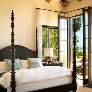 Design ideas for a mediterranean bedroom in Los Angeles with beige walls.