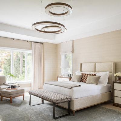 Large trendy master light wood floor and beige floor bedroom photo in DC Metro with beige walls