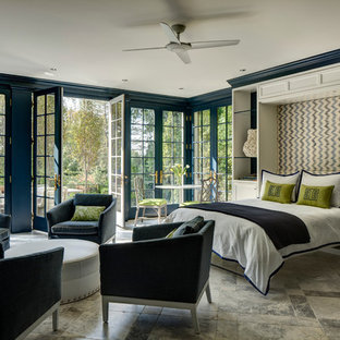 This is an example of a classic guest bedroom in DC Metro with blue walls.