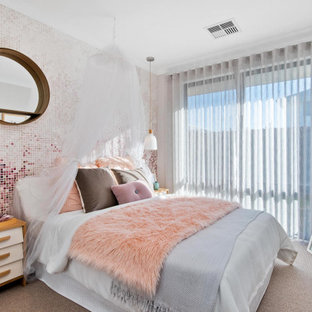 Photo of a contemporary bedroom in Perth with multi-coloured walls, carpet and grey floor.