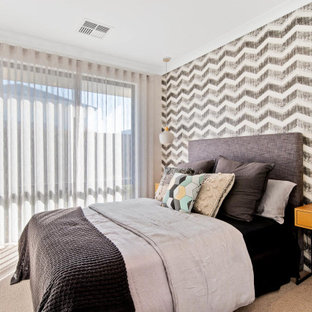 This is an example of a contemporary bedroom in Perth with multi-coloured walls, carpet and grey floor.