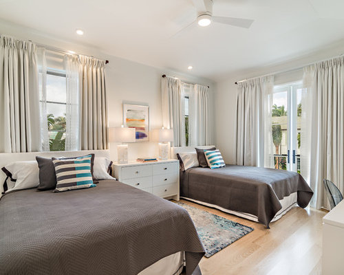 Example Of A Transitional Guest Light Wood Floor And Beige Floor Bedroom  Design In Miami With