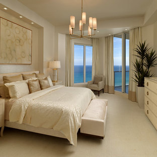 Inspiration for a mid-sized transitional master bedroom in Miami with beige walls and marble floors.