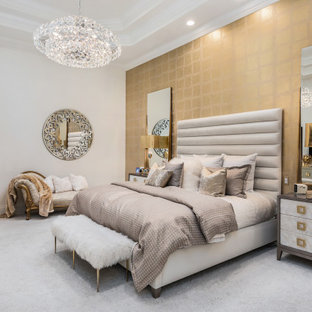 Example of a trendy carpeted, gray floor, tray ceiling and wallpaper bedroom design in Miami with white walls