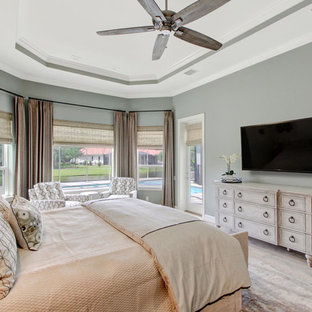 Example of a large transitional master light wood floor bedroom design in Orlando with green walls and no fireplace