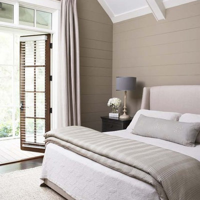 Inspiration for a large timeless master dark wood floor bedroom remodel in Charleston with beige walls and no fireplace