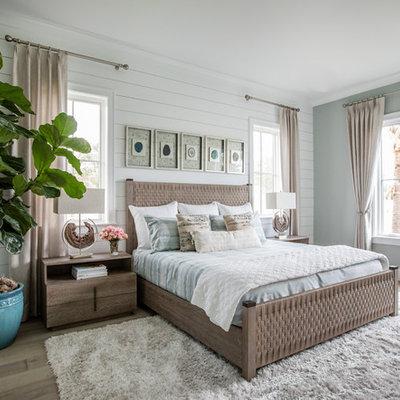 Bedroom - coastal master light wood floor and beige floor bedroom idea in Jacksonville with white walls and no fireplace