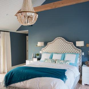 Bedroom - transitional light wood floor bedroom idea in San Francisco with blue walls