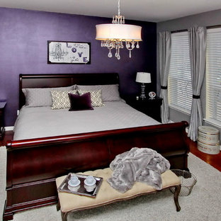 Photo of a large traditional master bedroom in Tampa with purple walls, medium hardwood floors, no fireplace and brown floor.