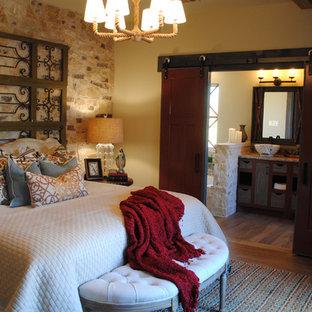 Example of an eclectic master vinyl floor bedroom design in Austin with beige walls
