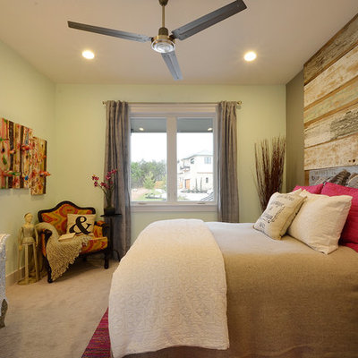 Example of a trendy carpeted bedroom design in Austin with gray walls and no fireplace