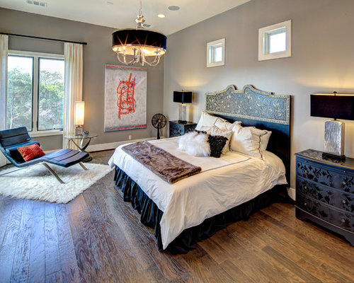 Beau Large Trendy Master Medium Tone Wood Floor Bedroom Photo In Austin With  Gray Walls