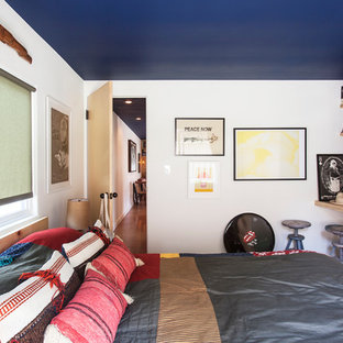 Inspiration for an eclectic carpeted bedroom remodel in Los Angeles with white walls