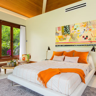 Example of a large island style master carpeted and beige floor bedroom design in Hawaii with white walls and no fireplace