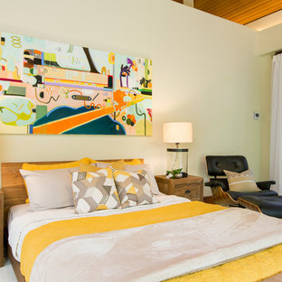 Inspiration for a mid-sized tropical master carpeted and beige floor bedroom remodel in Hawaii with beige walls and no fireplace