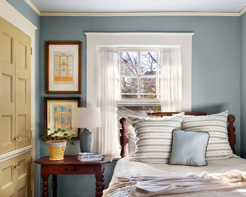 Example Of A Classic Bedroom Design In New York With Blue Walls