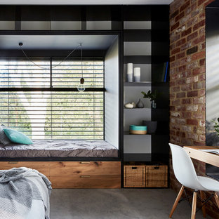 Inspiration for an industrial bedroom in Melbourne with carpet and grey floor.