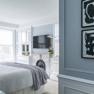 Bedroom - mid-sized transitional master dark wood floor bedroom idea in New York with gray walls, a standard fireplace and a stone fireplace