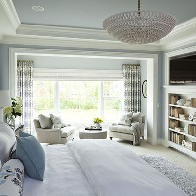 Huge elegant master carpeted bedroom photo in Minneapolis with no fireplace and blue walls