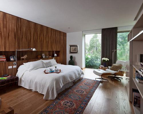 Contemporary Medium Tone Wood Floor Bedroom Idea In Mexico City With White Walls