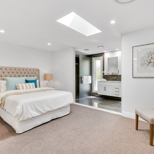 Beach style master bedroom in Gold Coast - Tweed with white walls, carpet and beige floor.