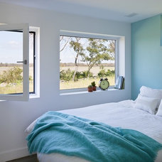 farmhouse bedroom by ZeroEnergy Design