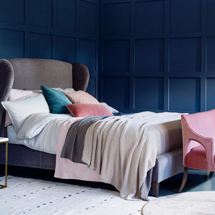 Inspiration for a large classic master bedroom in Surrey with blue walls, concrete flooring and no fireplace.