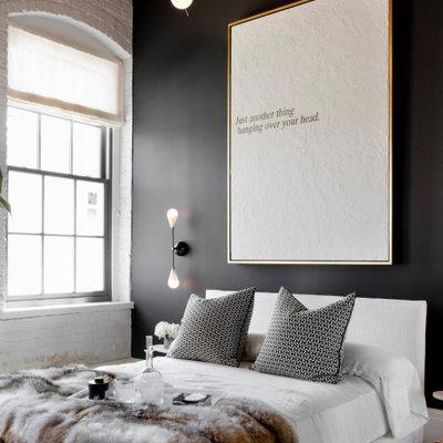 Example of a mid-sized urban medium tone wood floor, brown floor, wood ceiling and brick wall bedroom design in San Francisco with black walls