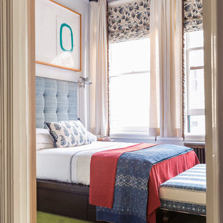 Inspiration for a mid-sized eclectic guest carpeted and green floor bedroom remodel in New York with blue walls and no fireplace