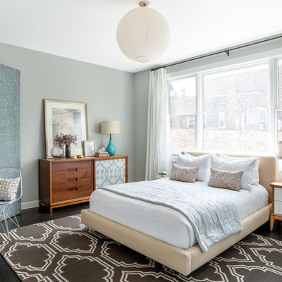 Inspiration for a transitional dark wood floor and brown floor bedroom remodel in Chicago with green walls