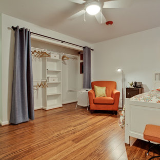 Example of a mid-sized midcentury modern guest bamboo floor bedroom design in Dallas with white walls and no fireplace